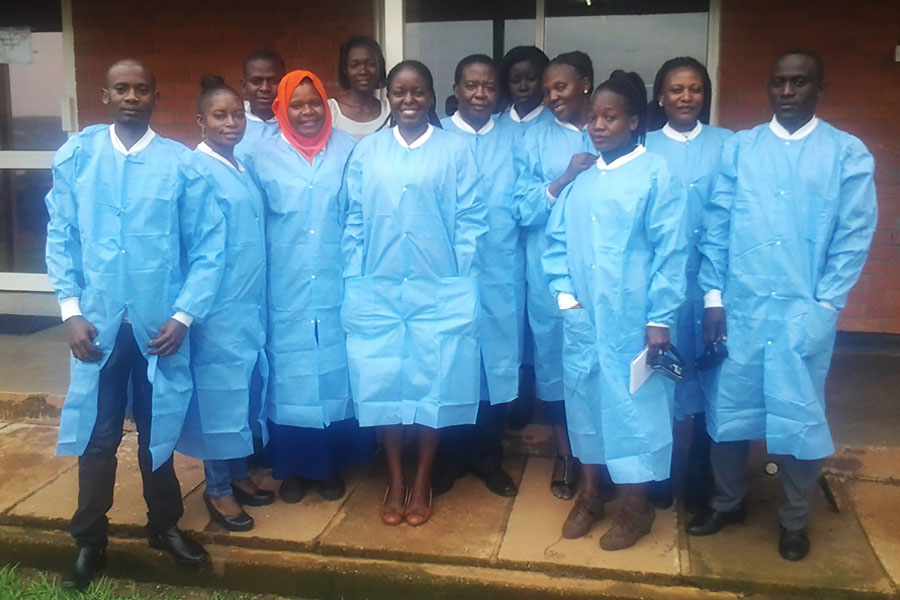 Group photo of the journalists and facilitators shortly after touring the Mildmay Uganda Laboratory