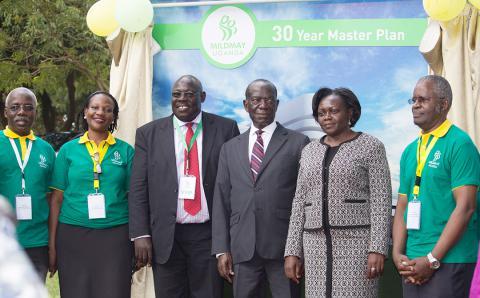 Dr. Barbara Mukasa, ED-MUg, H.E. Hon Edward Sekandi, Hon. Sarah Opendi, Prof Sam Luboga MUg Board Chairman,  standing infront of the 30 Year Master Plan model at the Launch Event